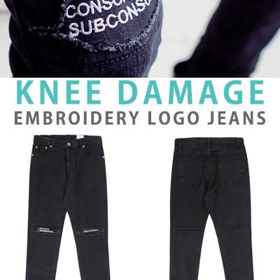 ひざのダメージ刺繍ロゴジーンズ